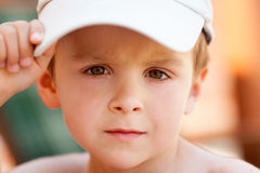 Close portrait of a boy with baseball cap Stock Photography