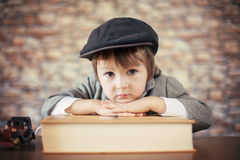 Close portrait of boy with big book Royalty Free Stock Photos