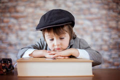 Close portrait of boy with big book Stock Image