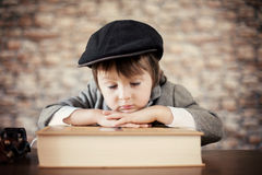 Close portrait of boy with big book Stock Photography