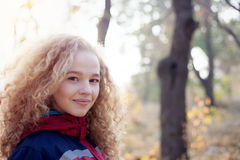 Close portrait cheerful young woman  curly hair smiling outdoors Royalty Free Stock Photos