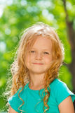 Close portrait of curly happy little girl outside Royalty Free Stock Image