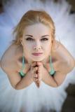Close portrait of a cute ballerina in white tutu Stock Photos
