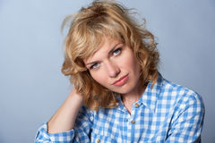 Close portrait of cute young blond fashion model in blue gingham Stock Images