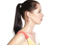 Close portrait of a girl in profile. Sports Royalty Free Stock Photos