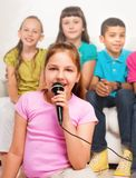 Close portrait of girl singing Stock Photo