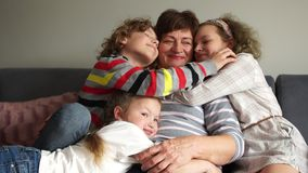 Close portrait. Grandmother and three grandchildren, a boy and a girl, brother and sister. Happy family, Christmas party