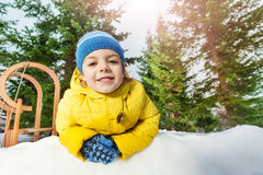 Close portrait of little boy in snow park Royalty Free Stock Photo