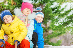 Close portrait of little kids in winter clothes Royalty Free Stock Images