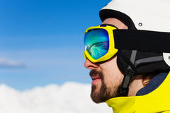 Close portrait of man in ski mask over mountains Stock Photo