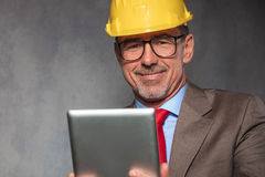 Close portrait of mature engineer wearing helmet Royalty Free Stock Photos