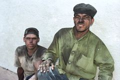Close portrait of Paraguayan charcoal makers royalty free stock photo