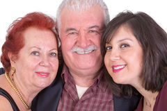 Close Portrait of Senior Couple and Their Daughter on Fathers Da Royalty Free Stock Photo