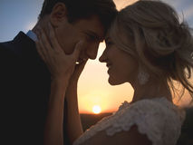 Close portrait silhouette in love wedding couple. Against the se Royalty Free Stock Photo