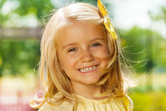 Close portrait of smiling happy blond little girl Royalty Free Stock Photos