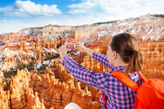 Close portrait of woman take Bryce canyon picture Stock Image