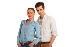 Close portrait of young couple posing with hands in pockets Royalty Free Stock Photography