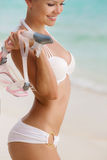 Close portrait of Young woman with wet skin and with a snorkeling equipment on sand and going to swim in clear ocean royalty free stock photo