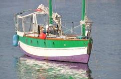 Close on Privately Built Sailboat. Close, three quarter profile of a privately built sailboat anchored near a marina Royalty Free Stock Photo