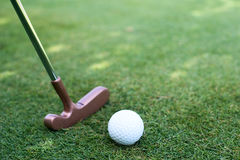 Close of putter and ball Royalty Free Stock Images