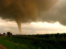 Close range footage of a tornado at sunset near a small farm. stock video