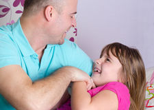 Close relationship between father and daughter Stock Photos