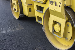 Close of road roller compacting asphalt Royalty Free Stock Photography