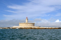Old Lighthouse Monument. A close sea view of a light house in the middle of the ocean royalty free stock photography