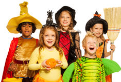 Close shoot of five kids in Halloween costumes Stock Image