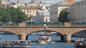 Close shot of the Anichkov Bridge and tour ships on the Fontanka river in the summer Stock Photo