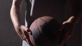 Close shot of basketball player`s hands playing with ball stock video footage
