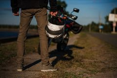 Close view on biker`s legs from the back royalty free stock photo