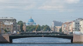 Close shot of bridges over The Fontanka River and The Trinity Cathedral in the summer. ST. PETERSBURG, RUSSIA - JULY 26, 2017: Close shot of bridges over The Royalty Free Stock Photo