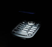 Close shot of cell phone in dark. Illuminating with white ligth of the screen Royalty Free Stock Photos