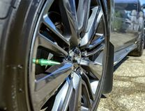 Close shot of chrome rims on a black car. Custom cars in Southern California summer 2017 Stock Image