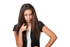 Close shot of confrontational young lady. Portrait of confrontational young woman, isolated on white Royalty Free Stock Photography