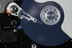 Close shot of hard drive head and disc. Stock Images