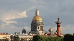 Close shot of Isaac`s Cathedral and the Rostral column - St. Petersburg, Russia stock video