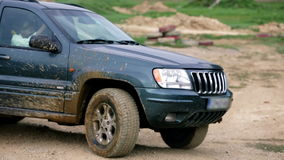 Close shot of jeep changing gears while driving backwards. Vehicles drive on rough terrain, through obstacles and in extreme weather conditions to practice stock video footage
