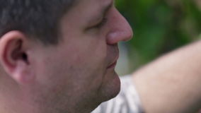 Close shot of man eating grape berries one after another. Visiting sea side stock video footage