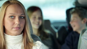Close shot of mother being angry at kids in car while driving to vacation stock video footage