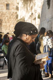 A close shot for praying woman at Western wall Stock Photo