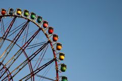 Close shot of rainbow ferris wheel. Close abstract shot of a rainbow-colored ferris wheel Royalty Free Stock Photo