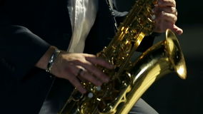 Close shot of saxophone player stock footage