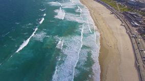 Waves in motion. A close shot of the waves in motion as they form in with the horizon in the distance in this drone shot stock footage
