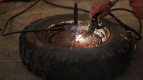 Close shot wheel repair. Welding parts stock footage