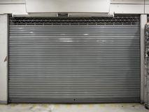 Close shutter or rolling door of shop background with copy space royalty free stock image