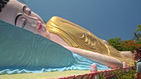 Close Side View Head of Large Lying Buddha in Temple Park stock video