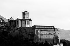 Close, side view of papal St. Francis church in Assisi, Umbria, stock photo