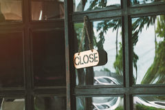 Close sign in a shop door concept for The store closes stock photography